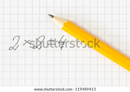 Simple math formula and pencil on squared paper - stock photo