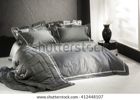 simple minimal and classic style bedroom interior , with black wall and black covers - stock photo