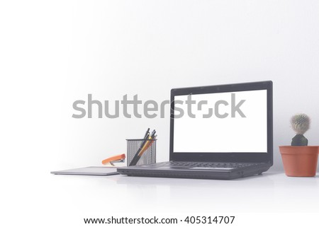Simple & modern office workspace portrait in soft color tone, with copyspace on white background - stock photo