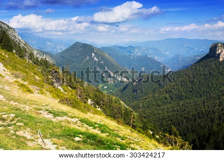 Simple mountains landscape in august cloudy day. Pyrenees - stock photo