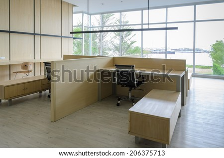 Simple office room with table and chair - stock photo
