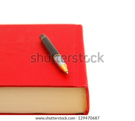 simple red hardcover book and pen  isolated on white background - stock photo