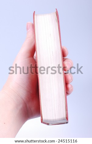 simple red hardcover book in hand - stock photo