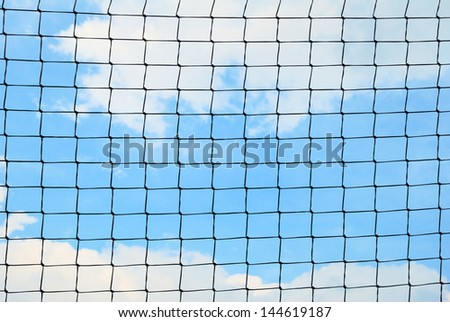 Simple sport safety net against a cloudy sky - stock photo