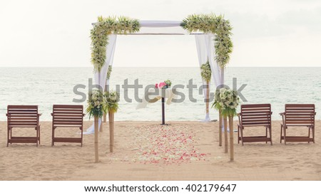 simple style wedding arch and decoration, venue, setup on tropical beach, outdoor beach wedding. Vintage process. - stock photo