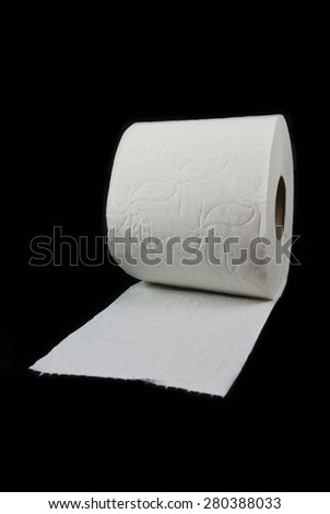 Simple toilet paper on black background - stock photo