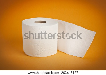 Simple toilet paper on yellow background - stock photo