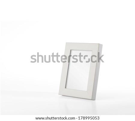 Simple, white desk photo frame - stock photo