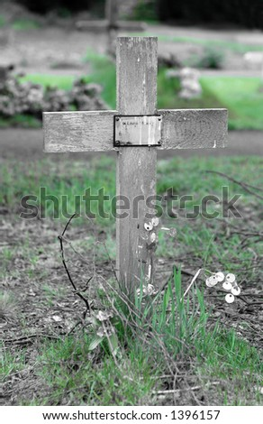 Simple wooden cross on grave - stock photo