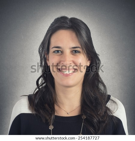 Simple young woman face smiling and optimistic - stock photo