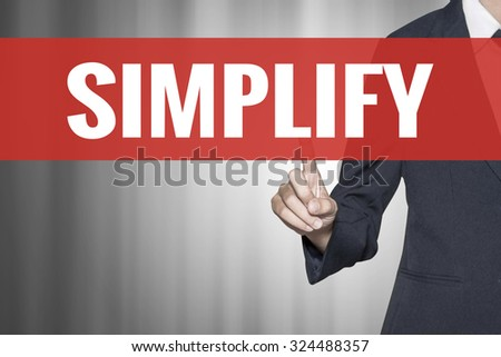 Simplify word on virtual screen push by business woman red tab - stock photo