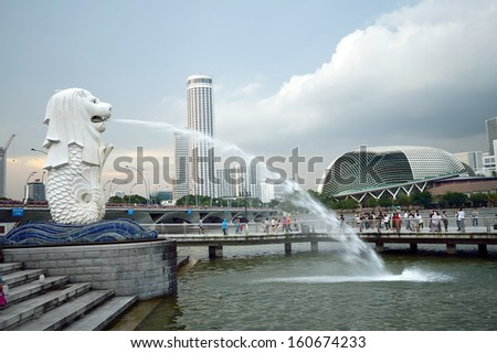 SINGAPORE-Apr 30:The Merlion fountain Apr 30, 2012 in Singapore.Merlion is a mythical creature with the head of a lion and the body of a fish,and is a symbol of Singapore.  - stock photo