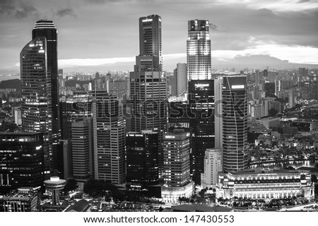 SINGAPORE - APRIL 15: A view of city from roof Marina Bay Hotel (b/w photo) on April 15, 2012 on Singapore. This hotel is billed as the world's most expensive standalone casino property at $8 billion. - stock photo