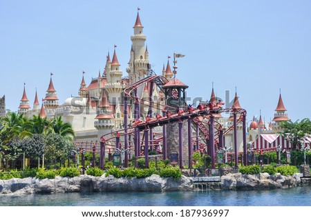 SINGAPORE-April 14: beautiful castle and roller coaster in Universal studio on April 14,2014. Universal Studios Singapore is theme park located within Resorts World Sentosa,Singapore. - stock photo