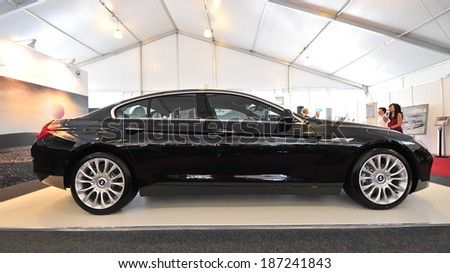 SINGAPORE - APRIL 12: BMW 640i gran coupe on display during Singapore Yacht Show at One Degree 15 Marina Club Sentosa Cove April 12, 2014 in Singapore - stock photo