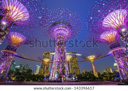 SINGAPORE -APRIL 6: Night view of Supertree Grove at Gardens by the Bay on April 6, 2013 in Singapore. Spanning 101 hectares of reclaimed land in central Singapore, adjacent to the Marina Reservoir - stock photo