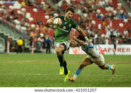 SINGAPORE-APRIL 17:South Africa 7s Team plays against Argentina 7s Team (blue/white) during Day 2 of HSBC World Rugby Singapore Sevens on April 17, 2016 at National Stadium in Singapore - stock photo