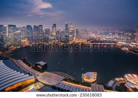 SINGAPORE - April 24: The Singapore skyline shines. Singapore has a highly developed market-based economy and is a center for commerce in Asia and globally  April 24, 2014 in Singapore - stock photo