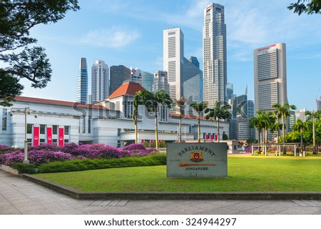 SINGAPORE - 07 AUG 2015: Parliament House in downtown Singapore, with modern, commercial highrise buildings in the background. - stock photo