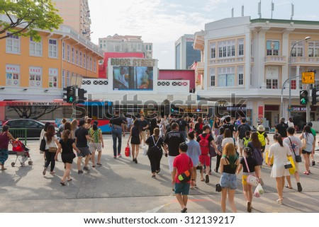 SINGAPORE-AUGUST 1,2015 :Bugis street shopping mall with person and tourism popular in bugis singapore. - stock photo