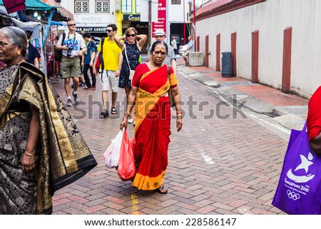SINGAPORE - 10 AUGUST, 2014: Chinatown famous district of Singapore. Traditional buildings facades and local culture sights are famous travel attractions - stock photo