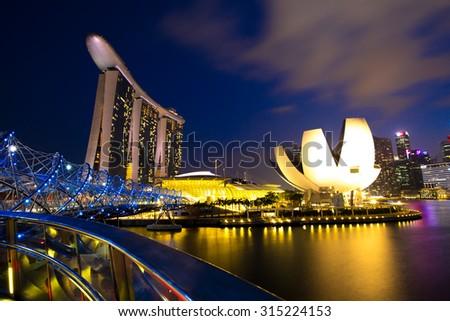 SINGAPORE - August 29 : The Helix Bridge, is a pedestrian bridge linking Marina Centre with Marina South in the Marina Bay area on August 29, 2015 in Singapore - stock photo