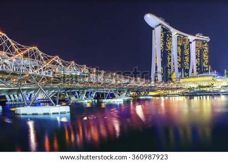 SINGAPORE - AUGUST 04, 2012: The Helix Bridge. Marina Bay Sand iconic design has transformed Singapore's skyline. Designed by architect Moshe Safdie.pore's skyline. Designed by architect Moshe Safdie. - stock photo