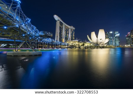 SINGAPORE - AUGUST 30: The Marina Bay Sands Resort standing majestically at the mouth of the Singapore River on August 30, 2015 in Singapore. This waterfront resort is a place of attraction. - stock photo