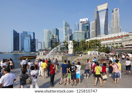 Singapore center with Merlion and skyscrapers - stock photo