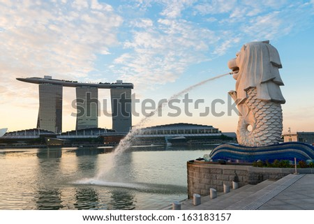 Singapore center with Merlion and skyscrapers at early morning - stock photo