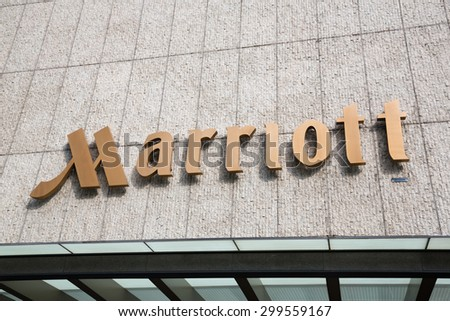 SINGAPORE - CIRCA FEBRUARY, 2015: Sign Marriott on the hotel. Marriott International, Inc. is an American diversified hospitality company that manages and franchises a broad portfolio of hotels. - stock photo
