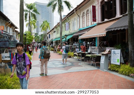 SINGAPORE - CIRCA FEBRUARY, 2015: Tourists in the streets of the Arab quarter (Kampong Glam). Arab Quarter is the oldest historic shopping district of Singapore, is popular for visiting tourists. - stock photo