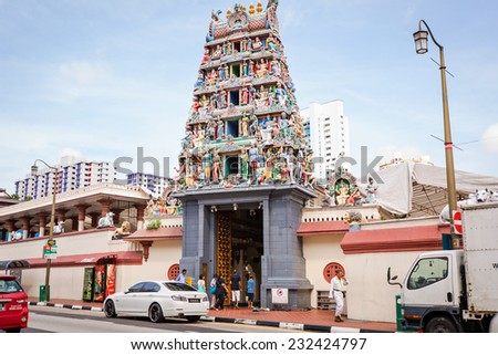 SINGAPORE - CIRCA MAY, 2014: Hindu temple Sri Mariamman in Singapore - one of the most colorful ethnic areas Singapore, is popular among tourists visiting Singapore from around the world. - stock photo