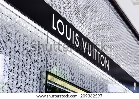 SINGAPORE - CIRCA MAY 2014: Louis Vuitton store. Forbes says that Louis Vouitton was the most powerful luxury brand in the world in 2008 with $19.4bn USD value. - stock photo