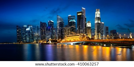 Singapore city skyline at dusk, Singapore referred to as the Lion City, the Garden City, and the Red Dot, is a global city and sovereign state in Southeast Asia. - stock photo