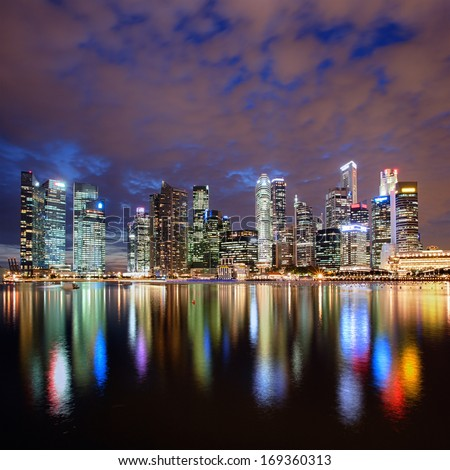 Singapore city skyline at night with reflection - stock photo