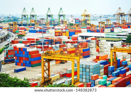 Singapore commercial port . It's the world's busiest port in terms of total shipping tonnage, it transships a fifth of the world shipping containers  - stock photo
