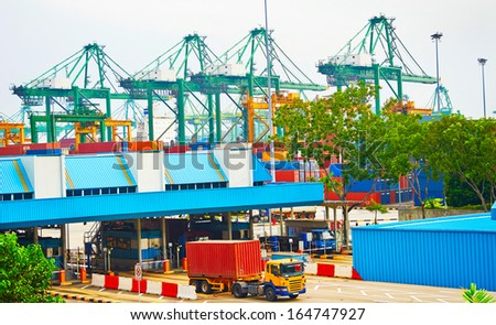 Singapore commercial port. It's the world's busiest port in terms of total shipping tonnage, it transships a fifth of the world shipping containers Stock Photo:  - stock photo