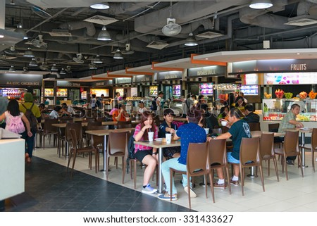 SINGAPORE - 31 DEC 2013: Modern food court at a major shopping center in Singapore's urban center. - stock photo