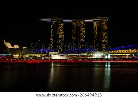 SINGAPORE-DEC 30, 2012: Nightscape of Singapore Marina Bay Sand on December 30, 2012, Singapore. Marina Bay Sands is billed as the world's most expensive standalone casino property at S$8 billion. - stock photo