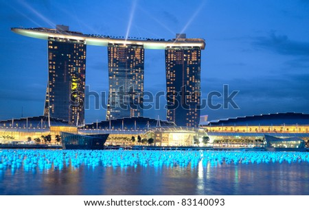 SINGAPORE-DEC 29: The 6.3 biliion dollar (US) Marina Bay Sands Hotel dominates the skyline at Marina Bay on Dec. 29, 2010 in Singapore. - stock photo