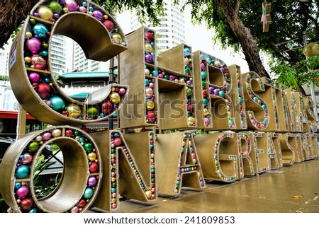 SINGAPORE - DECEMBER 29: Christmas Decoration at Singapore Orchard Road on December 29, 2014 in Singapore. The street with colourful christmas trees, ball, stars & dressed-up shopping centres. - stock photo