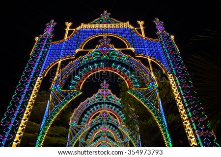 SINGAPORE - DECEMBER 22, 2015: Christmas Wonderland at Gardens by the Bay. It is biggest yuletide fair in Singapore. The 35,000 square-meter fair grounds will offer activities for visitors till Jan 3. - stock photo