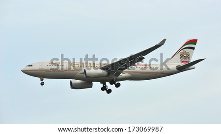 SINGAPORE - DECEMBER 25: Etihad Airways Airbus A330 with F1 2014 livery landing at Changi Airport on December 25, 2013 in Singapore - stock photo