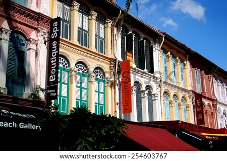 Singapore - December 27, 2007:  Galleries and shops occupy the ground floors of finely restored, colorfully painted former Chinese shop houses lining Pagoda Street in Chinatown  * - stock photo