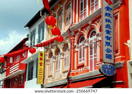 Singapore - December 14, 2007:  Splendidly restored and colourfully painted 19th century shop houses on Temple Street in Chinatown occupied by stores and restaurants - stock photo