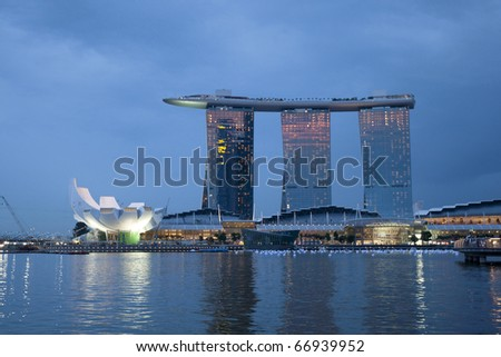 SINGAPORE - DECEMBER 3: The Marina Bay Sands Resort stands majestically at the mouth of the Singapore River. This waterfront resort and casino is a tourist attraction. December 3, 2010 in Singapore. - stock photo
