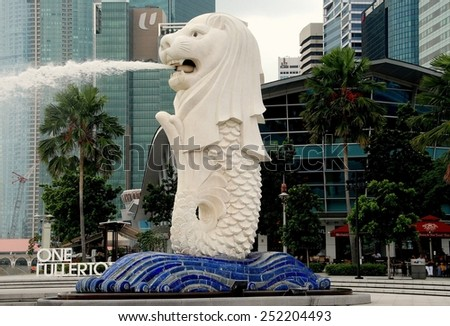 Singapore - December 12, 2007:  The 70 ton, 26 foot high Merlion Fountain, a lion's head on a fish's body, the city's symbol since its unveiling in 1972 in Merlion Park - stock photo