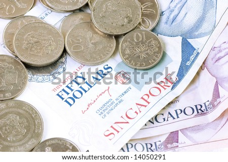 Singapore dollar notes and coins - stock photo