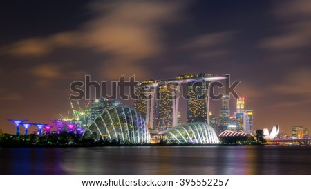 SINGAPORE - FEB 25, 2016: Cityscape of Singapore city skyline with Marina Bay Sands hotel and Gardens By The Bay at dusk in Marina Bay - stock photo